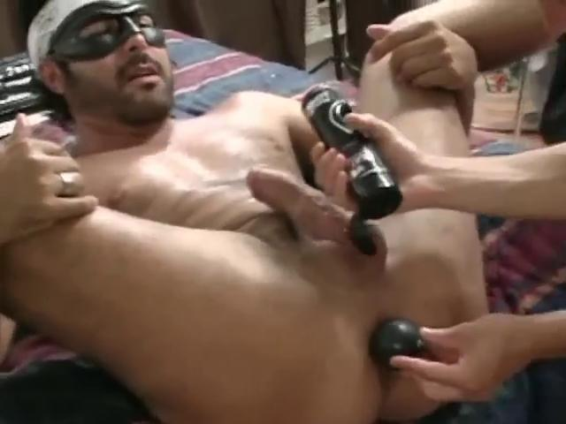 Masked hunky happy-go-lucky gets his tight aggravation stretched with a extended dildo