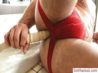 Muscled and tatooed stud filling his pain in the neck about dildo by gotmasked