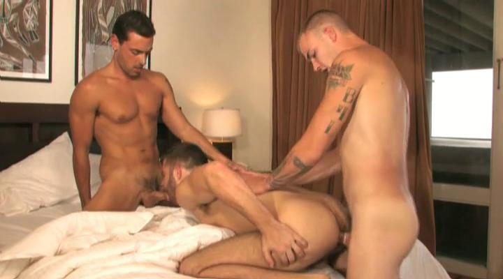 Three tanned and tattooed gay studs having threesome in be passed on house