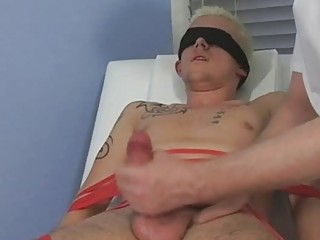 Tied and blindfolded blonde twink gets his cock sucked by mature gay papa