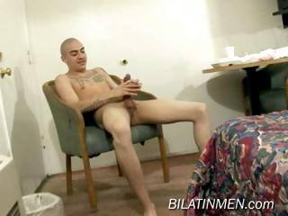 Hot latino guy strokes his big uncut verga