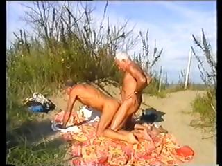 Horny gay transmute foxes play with each others cock at the beach